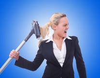 Geschäftsfrau mit Staubsauger auf Weiß Stockfotografie