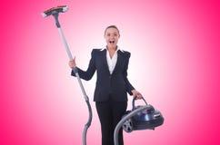 Geschäftsfrau mit Staubsauger auf Weiß Stockfoto