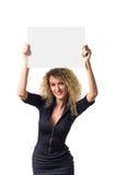 Geschäftsfrau mit unbelegtem Plakat Stockbilder