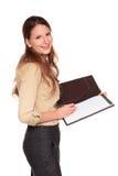 Geschäftsfrau - Schreiben auf Notizblock Stockfotografie