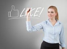 Geschäftsfrau schreiben Gleiches Lizenzfreies Stockfoto