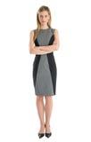Geschäftsfrau Standing Arms Crossed gegen weißen Hintergrund Stockfotos