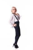 Geschäftsfrau steht nahe einem Stuhl Stockfotos