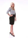 Geschäftsfrau-Stellung lizenzfreie stockbilder