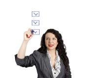 Geschäftsfrau und Checkliste Stockbild