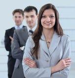 Geschäftsfrau und Geschäftsteam Lizenzfreie Stockfotos