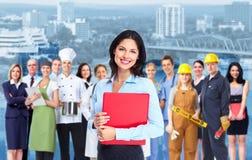 Geschäftsfrau und Gruppe Arbeitskraftleute. Lizenzfreies Stockfoto