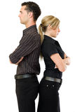 Geschäftsfrau und Mann, die zurück zu Rückseite stehen Stockbild