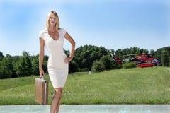 Geschäftsfrau vor einem Hubschrauber (1) Stockfotos