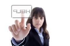 Geschäftsfrau, welche die Hilfentaste bedrängt Lizenzfreies Stockfoto