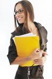 Geschäftsfraueinflußpapiere und -faltblatt Stockfotografie