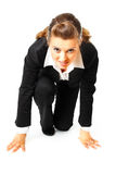 Geschäftsfrauen in der Anfangsstellung betriebsbereit zum Rennen Lizenzfreies Stockbild