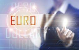 Geschäftsfrauen, die den Euroschirm berühren Lizenzfreie Stockfotografie
