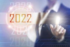 Geschäftsfrauen, die den Schirm 2022 berühren Lizenzfreie Stockfotos