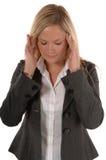 Geschäftsfrauen mit Kopfschmerzen stockfoto