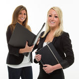 Geschäftsfrauen mit Portefeuilles Lizenzfreie Stockbilder