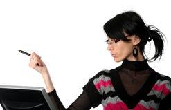 Geschäftsfraufunktion und zeigt auf die Feder Stockfotos