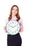 Geschäftsfraugriff eine Uhr und ein Lächeln stockbild
