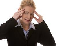 Geschäftsfraukopfschmerzen Stockfotos