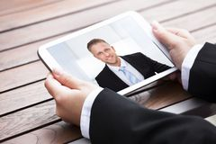 Geschäftsfrauvideo-conferencing mit Kollegen Lizenzfreies Stockfoto