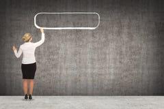 Geschäftsfrauzeichnung auf der Wand Stockfoto