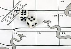 Geschäftsgefahrkonzept - Schlangen und Strichleitern Lizenzfreie Stockfotografie