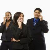Geschäftsgruppe an den Telefonen Lizenzfreie Stockfotografie