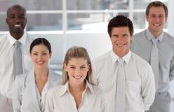 Geschäftsgruppe von fünf Leuten, die Kamera betrachten Lizenzfreies Stockbild
