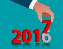 Geschäftshand, die 2017 hält Stockbild