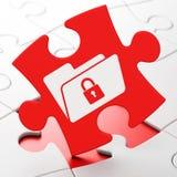 Geschäftskonzept: Ordner mit Verschluss auf Puzzlespiel Lizenzfreies Stockfoto