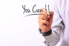 Geschäftskonzeptbild einer Hand, die Markierung hält und schreiben Sie kann lokalisiert auf Weiß Stockbild