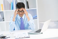 Geschäftskopfschmerzen Stockfoto