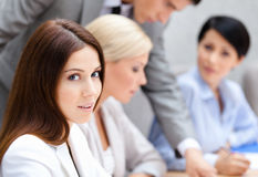 Geschäftsleute bei der Sitzung Stockbild
