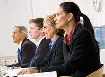 Geschäftsleute in der Sitzung Stockbilder