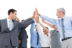 Geschäftsleute, die Handkontrollen tun Stockfotos