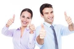 Geschäftsleute, die sich Daumen zeigen Stockbild