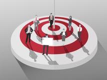 Geschäftsleute, die um rotes und weißes Ziel stehen Stockfoto