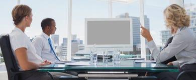 Geschäftsleute erfasst während einer Videokonferenz Lizenzfreie Stockfotografie