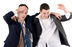 Geschäftsleute gefeuert, Umkippen. Stockbilder