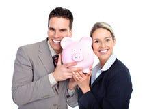 Geschäftsleute mit einer piggy Querneigung Stockbilder