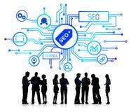 Geschäftsleute mit Geschäft SEO Concept Lizenzfreie Stockfotografie