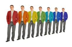 Geschäftsleute mit Regenbogenfarben-Mantelcollage Lizenzfreie Stockfotografie