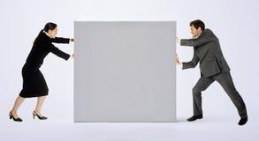 Geschäftsleute mit Zeichen Stockbilder