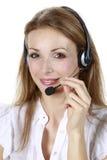 Geschäftsmädchen mit einem Mikrofon Lizenzfreie Stockfotos