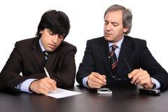 Geschäftsmänner auf einer Sitzung Stockbilder