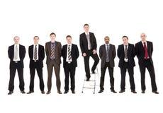 Geschäftsmänner in einer Reihe Stockbilder