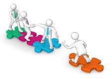 Geschäftsmänner farbige Puzzlespiele Lizenzfreie Stockfotos