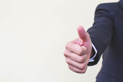 Geschäftsmänner geben Daumen für Geschäftshand für Texteingabe auf Stockbilder