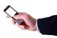 Geschäftsmänner hält Handy an Stockbilder