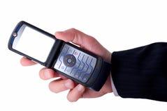 Geschäftsmänner hält Handy an Lizenzfreies Stockbild
